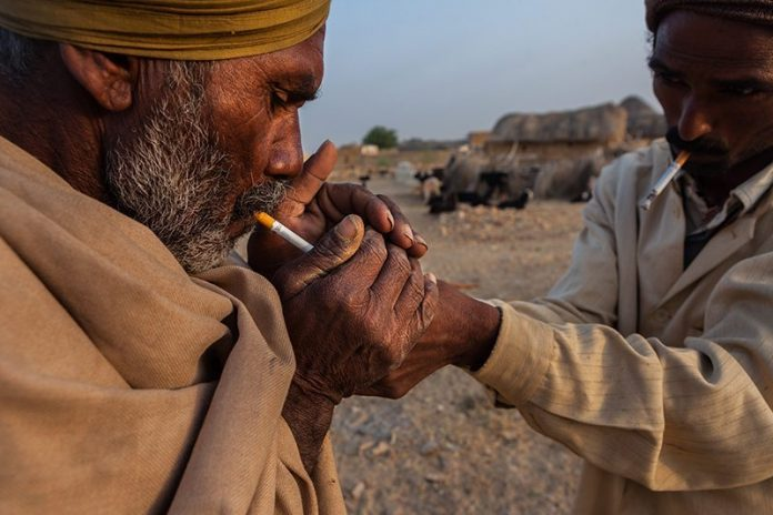 indian-man-lights-cigarette