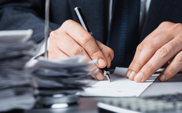 Man signing a paper